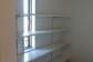 トランクルームには用途に応じて高さを変えられる可動棚を取り付けました。